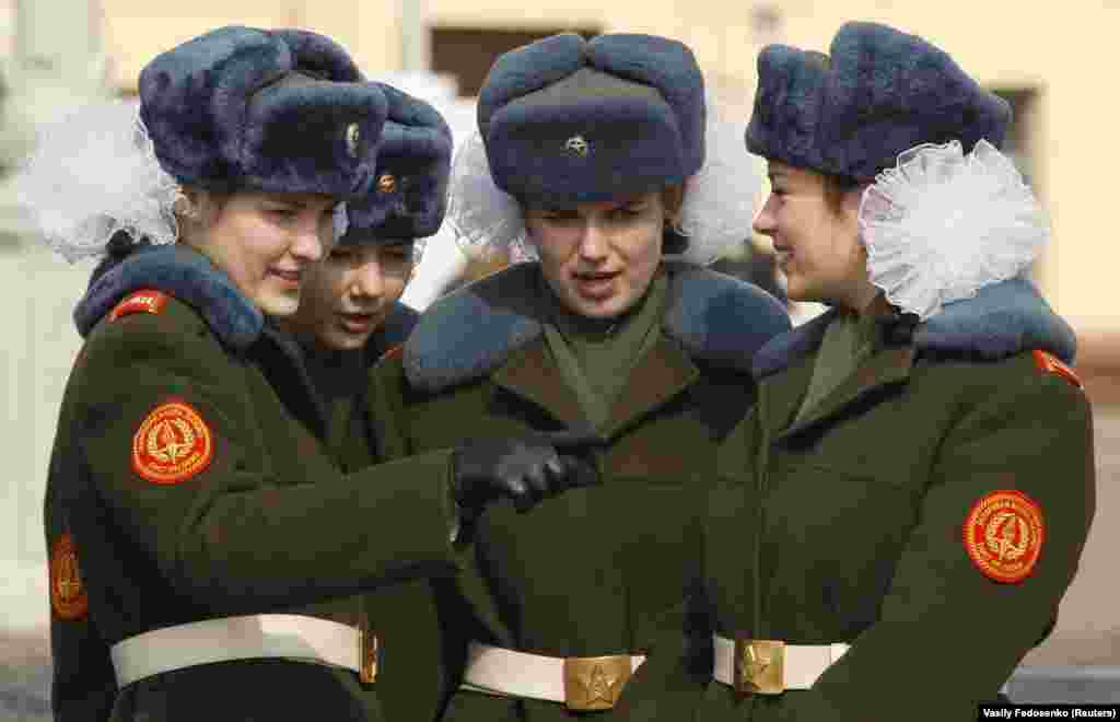 Belarusian girls attend an honor guard ceremony, which is part of the state patriotic education program and preparations for the upcoming Victory Day celebrations, on Victory Square in Minsk on April 11.