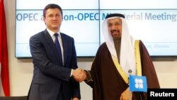 Russian Energy Minister Aleksandr Novak (left) and Saudi Energy Minister Khalid al-Falih in Vienna after an agreement between OPEC and 11 major oil producers outside the cartel to curb production beginning in January.