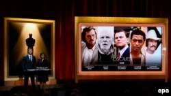 Австралия актеры Chris Hemsworth (с) һәм Академия президенты Cheryl Boone Isaacs 86нчы сезонның намзәтләрен игълан итә. Лос-Анҗелес, 16 гыйнвар 2014