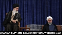A handout photo made available by the Supreme leader official website shows Iranian president Hassan Rouhani (R) and Iranian supreme leader Ali Khamenei (L) at Rouhani's confirmation ceremony, August 3.