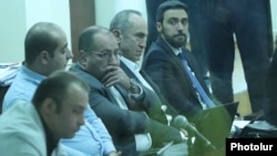 Armenia -- Former President Robert Kocharian (second from right) and his lawyers attend a court hearing in Yerevan, January 9, 2020.