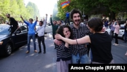 Protesters celebrate at an antigovernment rally in central Yerevan on April 23.