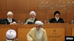 Guardian Council members; Mahmoud Hashemi Shahroudi (R), and Ahmad Jannati (C), attending a session of Assembly of Experts in 2015.