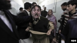 A relative of one of the victims of the attack reacts at a local hospital in Peshawar on February 13.