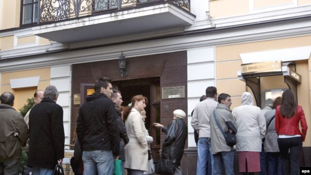 Depositors at an ATM in Kyiv in early October.