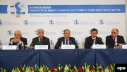 Russia's Sergei Lavrov (center) speaks on the podium with his counterparts from the other four Caspian littoral states at a news conference in Moscow on April 22.