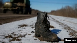 A military boot is seen on the road near Debaltseve, eastern Ukraine, on February 17.