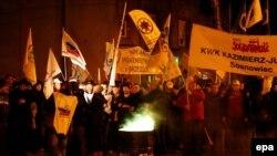 Работики угольных шахт с семьями бастуют в польском городе Бжеще. 14 января 2015 года.