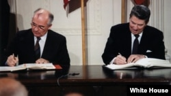 Soviet leader Mikhail Gorbachev (left) and U.S. President Ronald Reagan sign the INF Treaty in 1987.