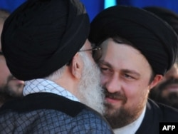 Supreme leader Ayatollah Ali Khamenei (L) kisses Hassan Khomeini, grandson of the founder of Islamic Republic, Ayatollah Ruhollah Khomeini during the 21st anniversary of Khomeini's death. Tehran, June 4, 2010