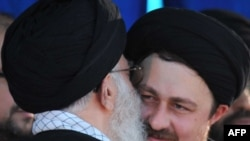 Supreme leader Ayatollah Ali Khamenei (left) kisses Hassan Khomeini, grandson of late founder of Islamic Republic, on the anniversary of his death.