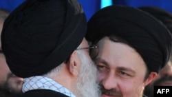 Supreme leader Ayatollah Ali Khamenei (left) kisses Hassan Khomeini, grandson of late founder of Islamic Republic, on the anniversary of his death.