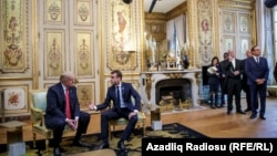 U.S. President Donald Trump and French President Emmanuel Macron meet at Elysee presidential palace.