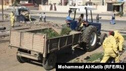 عمال في بلدية الموصل