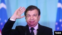 Uzbek President-elect Shavkat Mirziyaev speaks to his supporters in Tashkent on December 5.