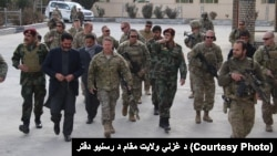 FILE: Gen. Austin S. Miller US army commander in Afghanistan during meeting with the governor of Ghazni Province in November.