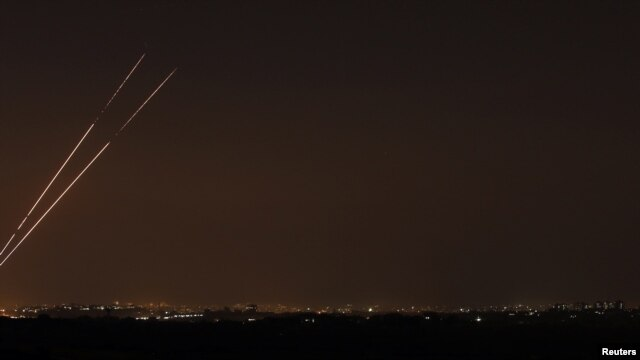 Rockets are seen in the night sky after they were launched from the northern Gaza Strip toward Israel on November 20.