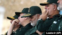 IRAN -- Gen. Qassem Soleimani (C), who heads the elite Quds Force of Iran's Revolutionary Guard attends a graduation ceremony of a group of the guard's officers in Tehran,June 30, 2018
