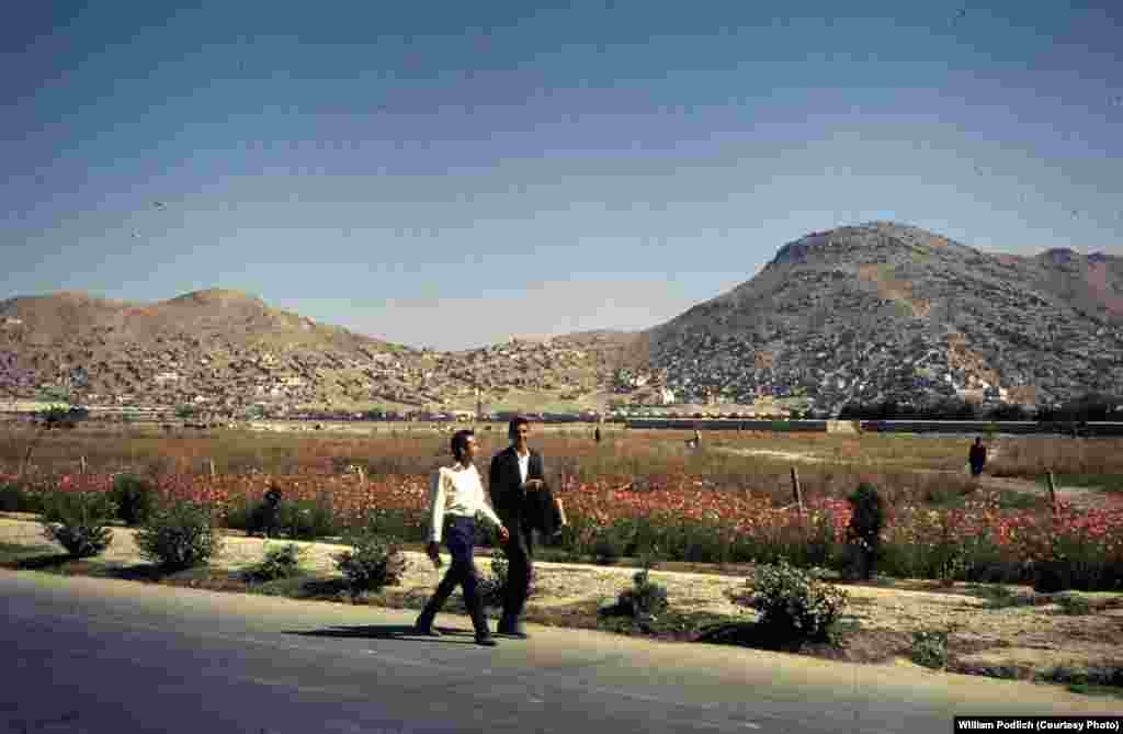 Young boys walk home on the outskirts of Kabul.