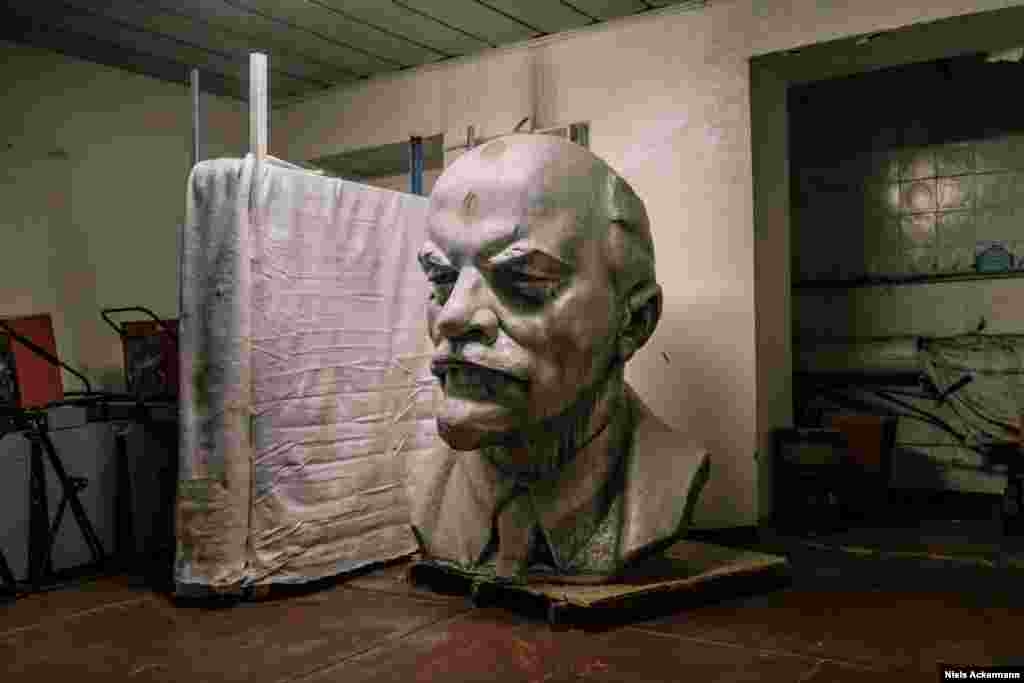 A giant Lenin in a storage room in Chernobyl. Ackermann was initially told by the local authorities that the head was too radioactive to be safely photographed.
