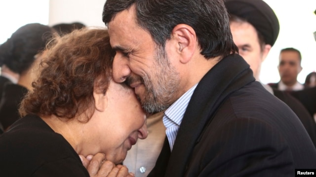 Iranian President Mahmud Ahmadinejad offers his condolences to Elena Frias, mother of Venezuela's late President Hugo Chavez, during the funeral service at the Military Academy in Caracas on March 8. The photo was released to the media by the press office of the Venezuelan presidency.