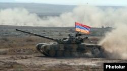 Armenia - An Armenian battle tank takes part in CSTO military exercises at the Marshal Bagramian shooting ground, 19Sep2012.