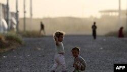 Дети внутренне перемещенных лиц в лагере близ Эрбиля, административного центра Иракского Курдистана.