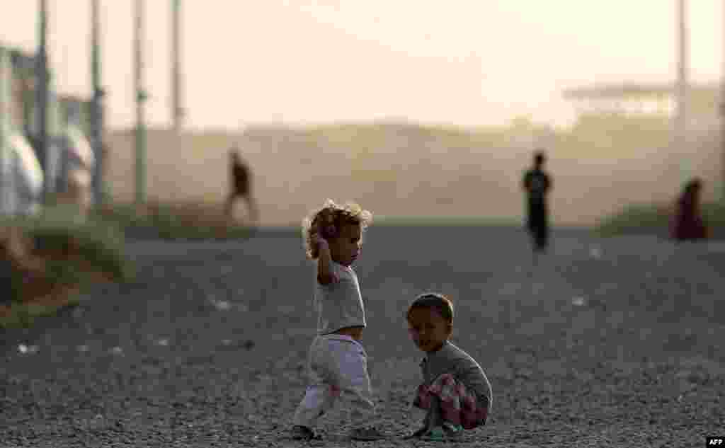 Displaced children play outside on the first day of the Muslim holy month of Ramadan, at the Al-Khazir camp for the internally displaced, located between Irbil and Mosul, Iraq. (AFP/Karim Sahib)