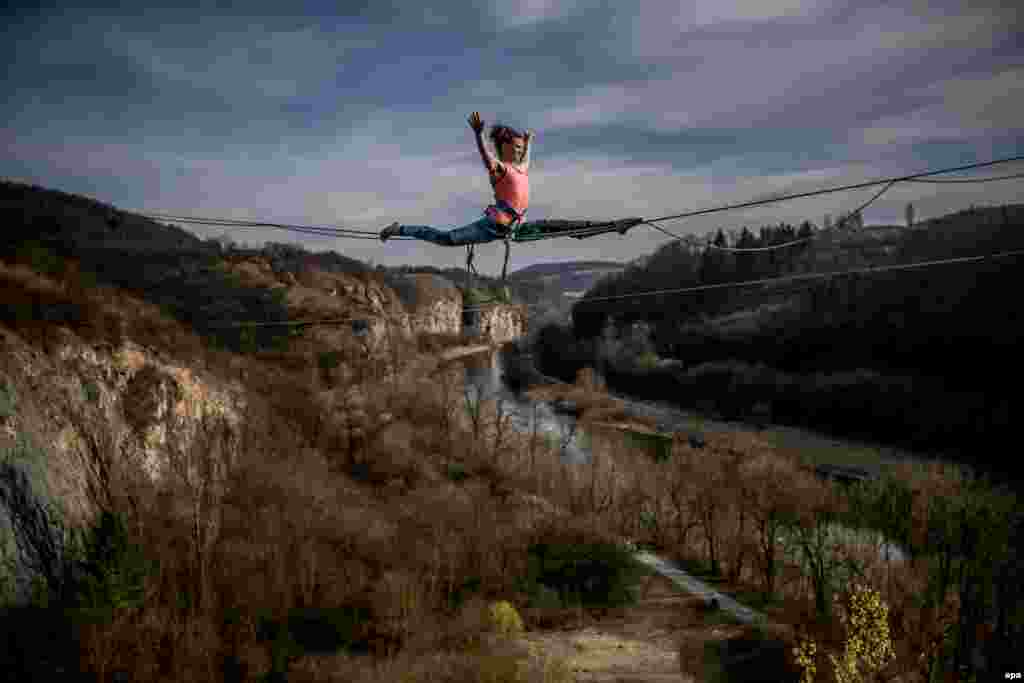 A woman takes part in a highline event in a former quarry, near the village of Srbsko in the Czech Republic. (epa/Martin Divisek)