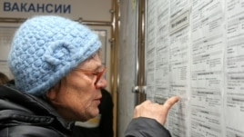 A woman looks at job listings in Kemerovo during a job fair in November.