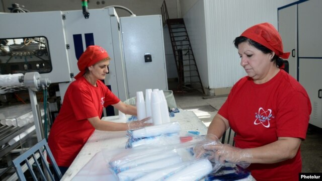 Armenia – Workers at a plastics factory in Yerevan, 30Oct2013.