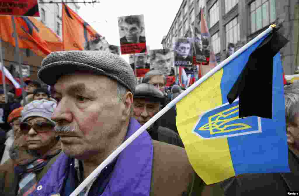 A man holds a Ukrainian national flag during the Nemtsov march.