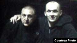 Mikalay Autukhovich (right) in a photo reportedly taken in prison in 2010