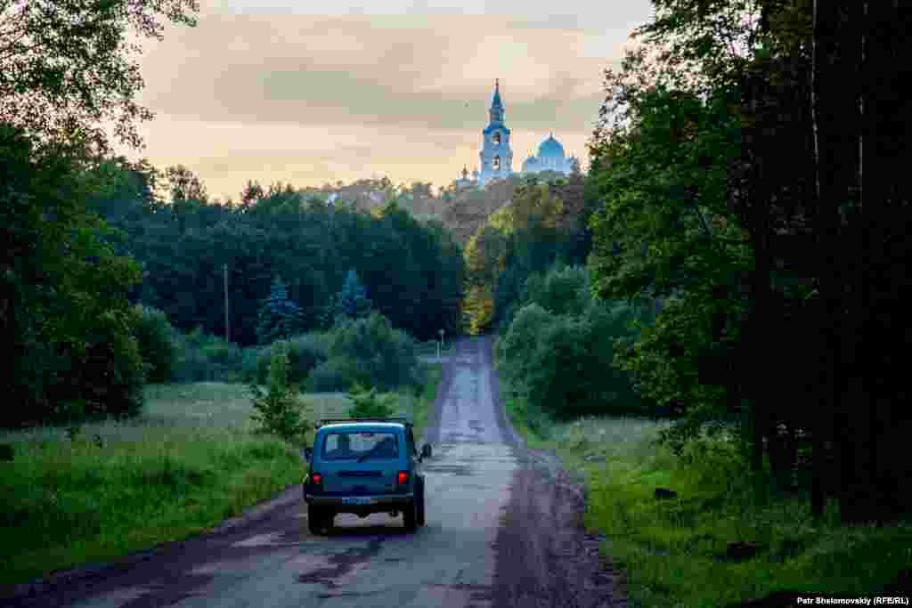 A Soviet-made Niva car drives toward the Valaam Monastery.