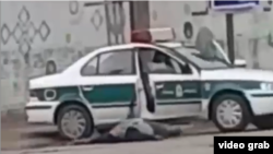 A gunman wounded on the ground after shooting a policeman in the city of Shadehgan, Iran. December 3, 2019