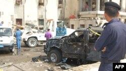 Ирактың Басра қаласында полиция бекетінің алдындағы көлікте жарылыс болды. Ирак, 13 маусым 2011 жыл.