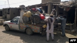 People pack belongings into a van in Miranshah in the North Waziristan tribal agency on June 13. More than 50,000 residents have reportedly fled their homes in the region.