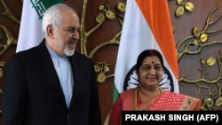 Indian Foreign Minister Sushma Swaraj (right) poses for photos with Iranian Foreign Minister Mohammad Javad Zarif prior to a meeting in New Delhi on May 14.