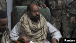 Saif al-Islam Qaddafi after his capture, in the custody of revolutionary fighters.