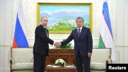 Президент России Владимир Путин и премьер-министр Узбекистана Шавкат Мирзияев, Самарканд, 6 сентября 2016 года.