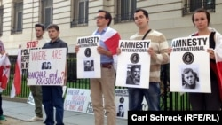 Protesters near the Belarusian Embassy in Washington marked the 15th anniversary of the disappearance of two critics of the regime of Belarusian President Alyaksandr Lukashenka.
