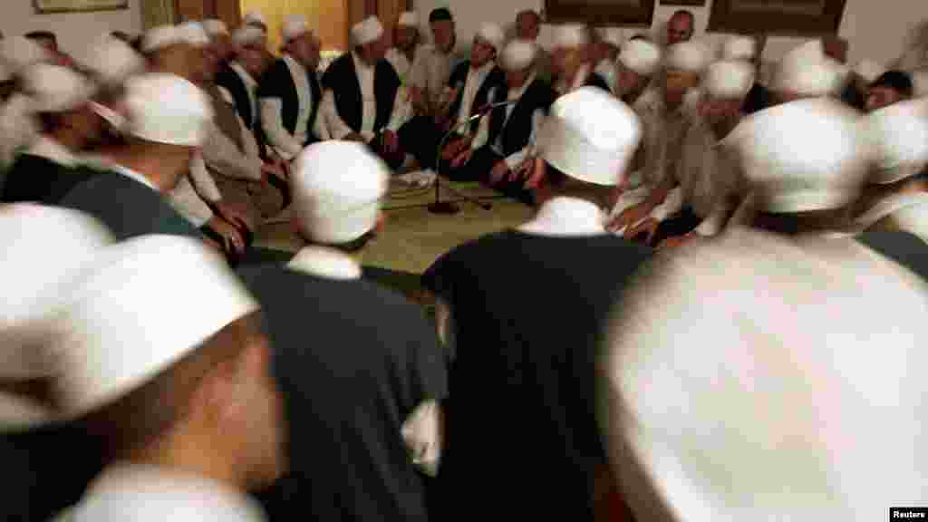 Dervishes perform and pray on Laylat al-Qadr (Night of Decree) during the holy month of Ramadan at Mesudija tekke in Kacuni, Bosnia-Herzegovina. (Reuters/Dado Ruvic)