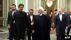 "Iranian President Hassan Rouhani (R) meeting with Pakistani Prime Minister Imran Khan in the Iranian capital Tehran. - Rouhani announced the creation of a joint border ""reaction force"" with Pakistan to counter terrorism in the meeting today with Khan in T"
