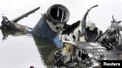 A rescue diver works next to the wreckage of the Yakovlev-42 passenger plane that crashed near the city of Yaroslavl, north of Moscow.