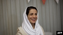 Iranian lawyer Nasrin Sotoudeh smiles at her home in Tehran on September 18, 2013