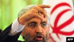 Said Jalili takes questions at a press conference at the Iranian Embassy in Beijing.