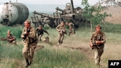 Russia -- Russian special forces enter a Chechen village. May 1996