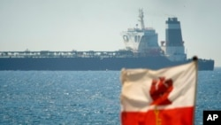 A view of the Grace 1 super tanker in the British territory of Gibraltar, Thursday, July 4, 2019. (AP Photo/Marcos Moreno)