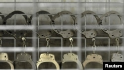 Handcuffs hang in the U.S. detention facility at Guantanamo Bay.