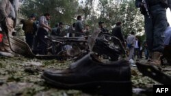 A victim's shoe lies on the ground as police secure the site of a suicide attack in Kabul last month.